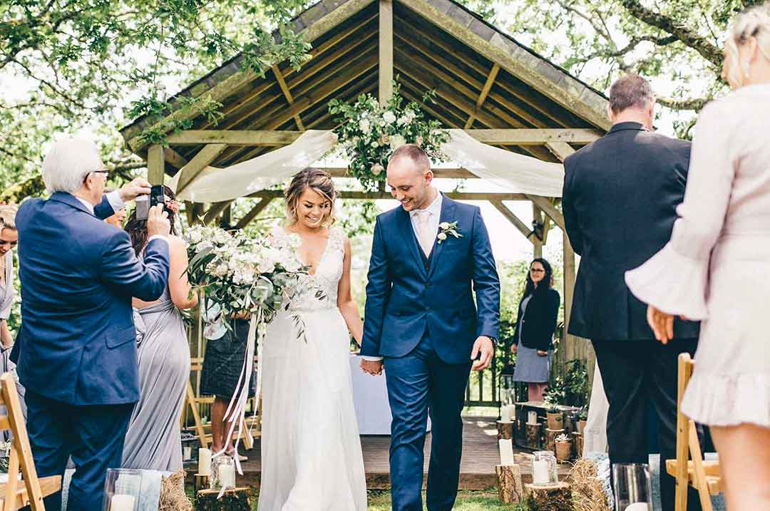 Fabric wedding arch with married couple
