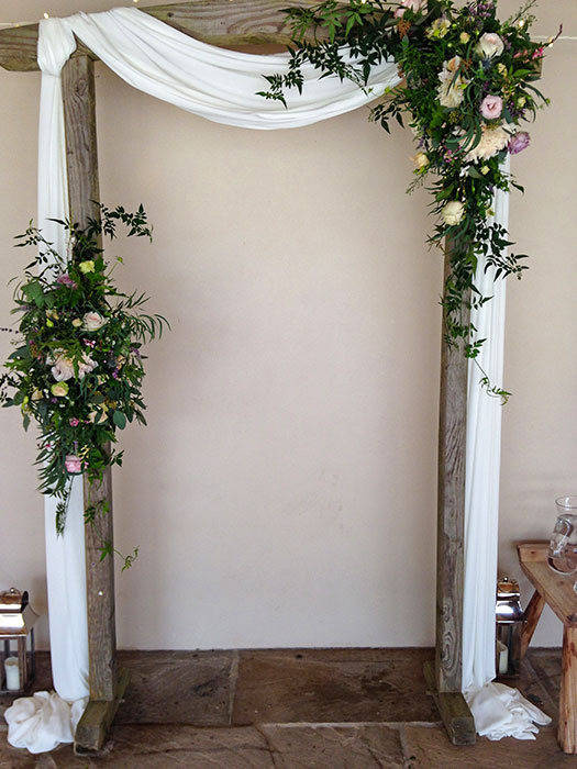 Fabric flower arch for wedding