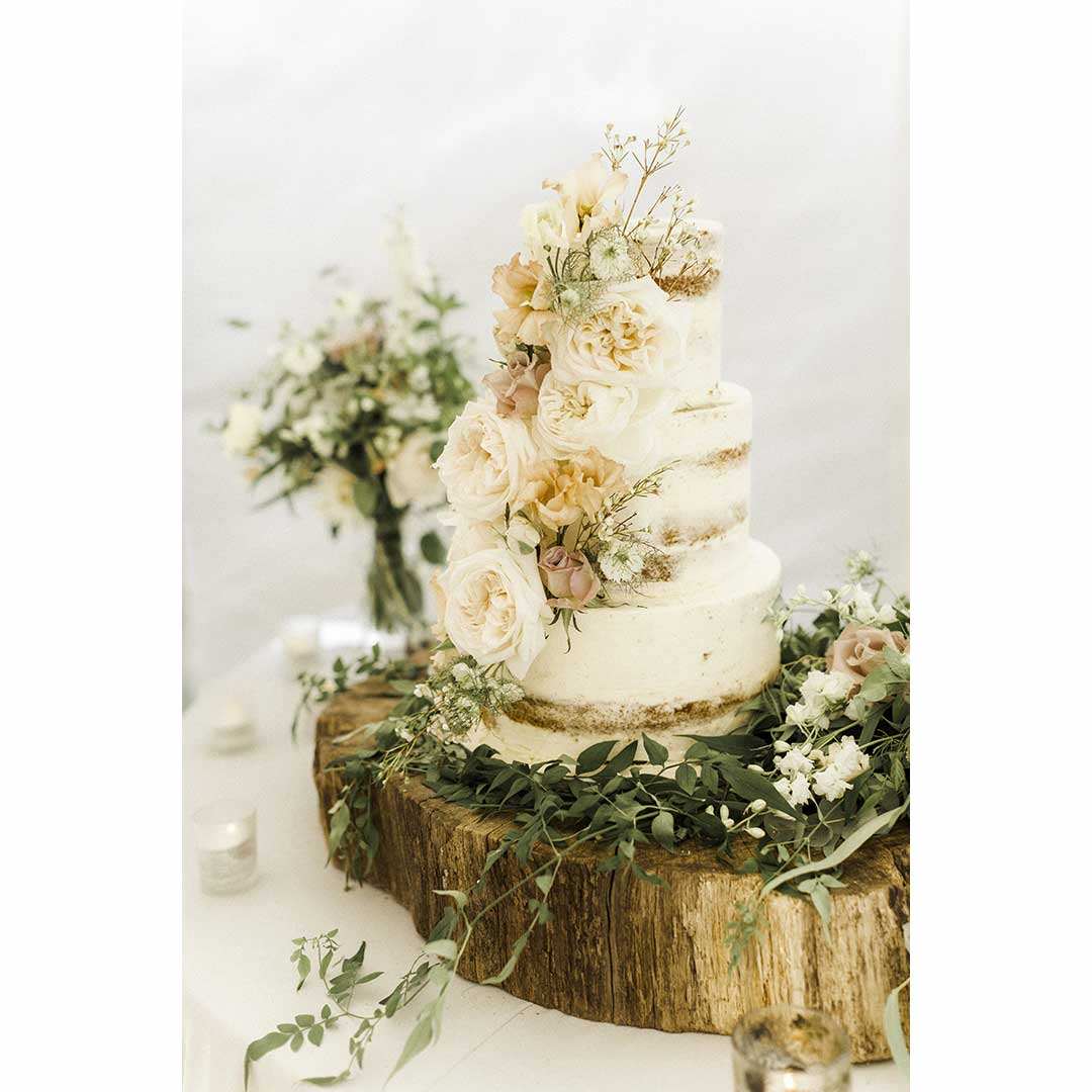 country style wedding flowers on 3 tier wedding cake