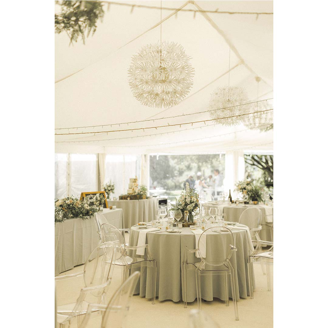 Wedding marquee covered in country-style wedding flowers