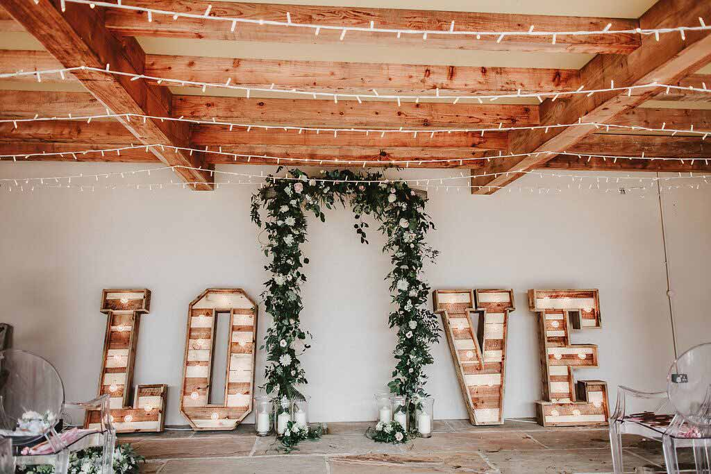 White wedding flower arch