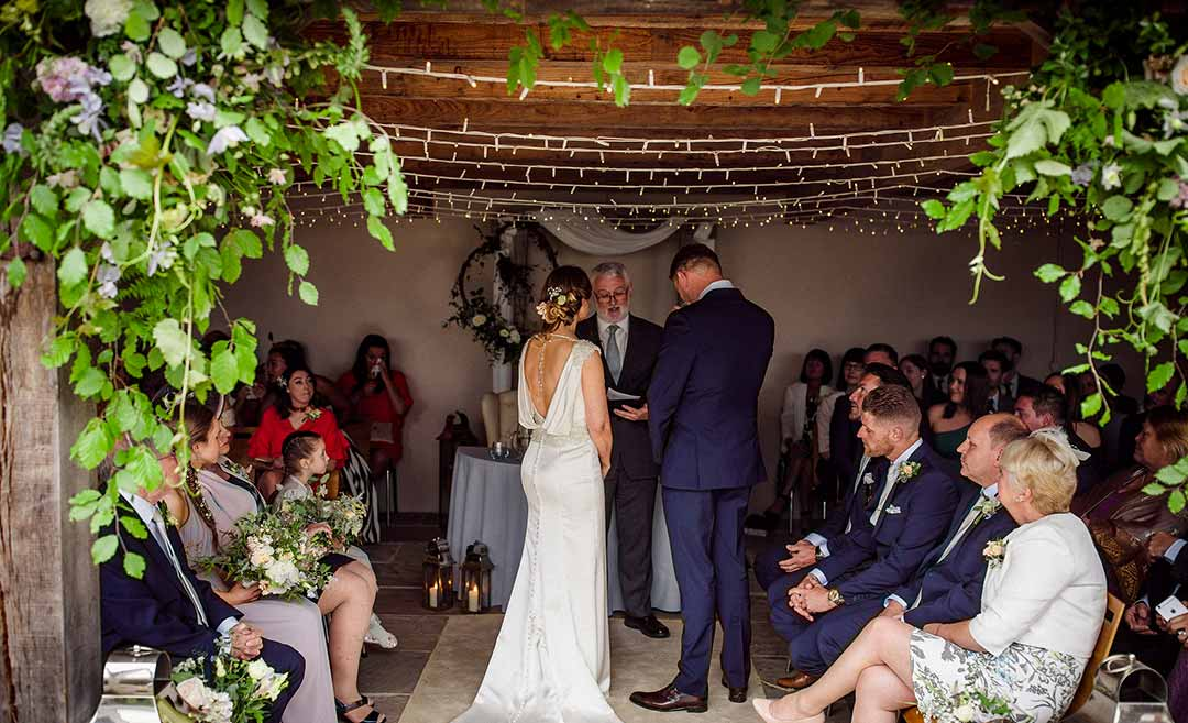 Partial Flower Arches with bride and groom