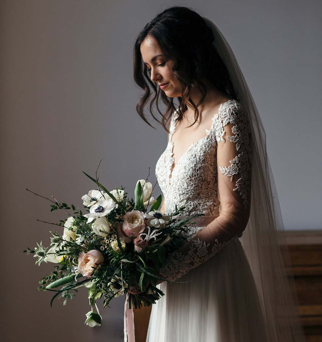 Bride with winter bouquet of flowers