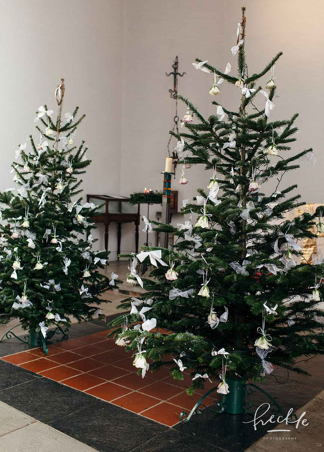Christmas trees decorated for a winter wedding