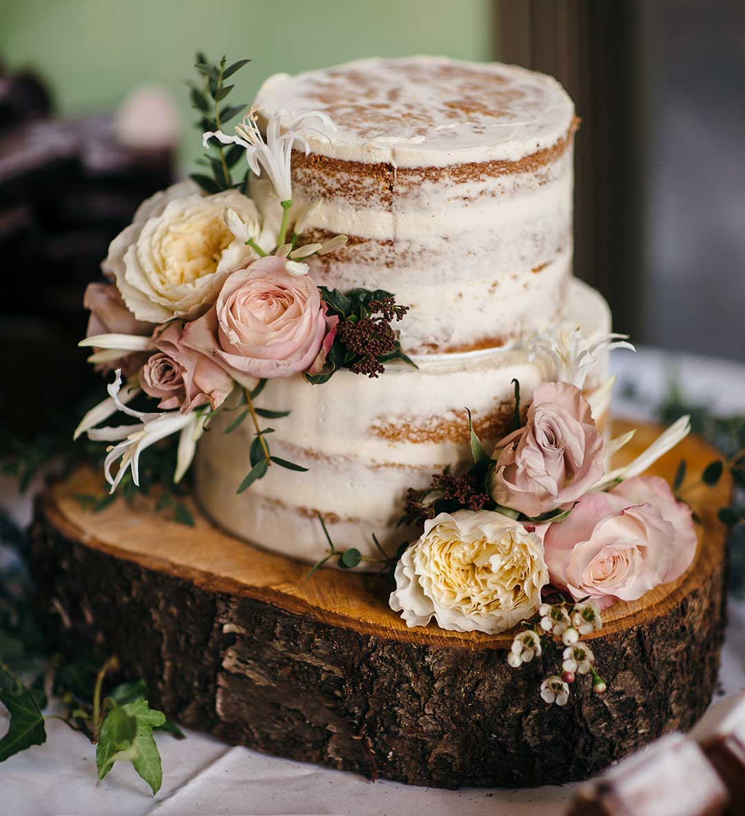 Wedding cake decorated with winter flowers