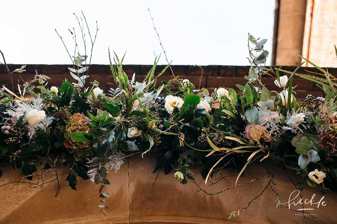 Winter flower display decorating Exeter University Chapel