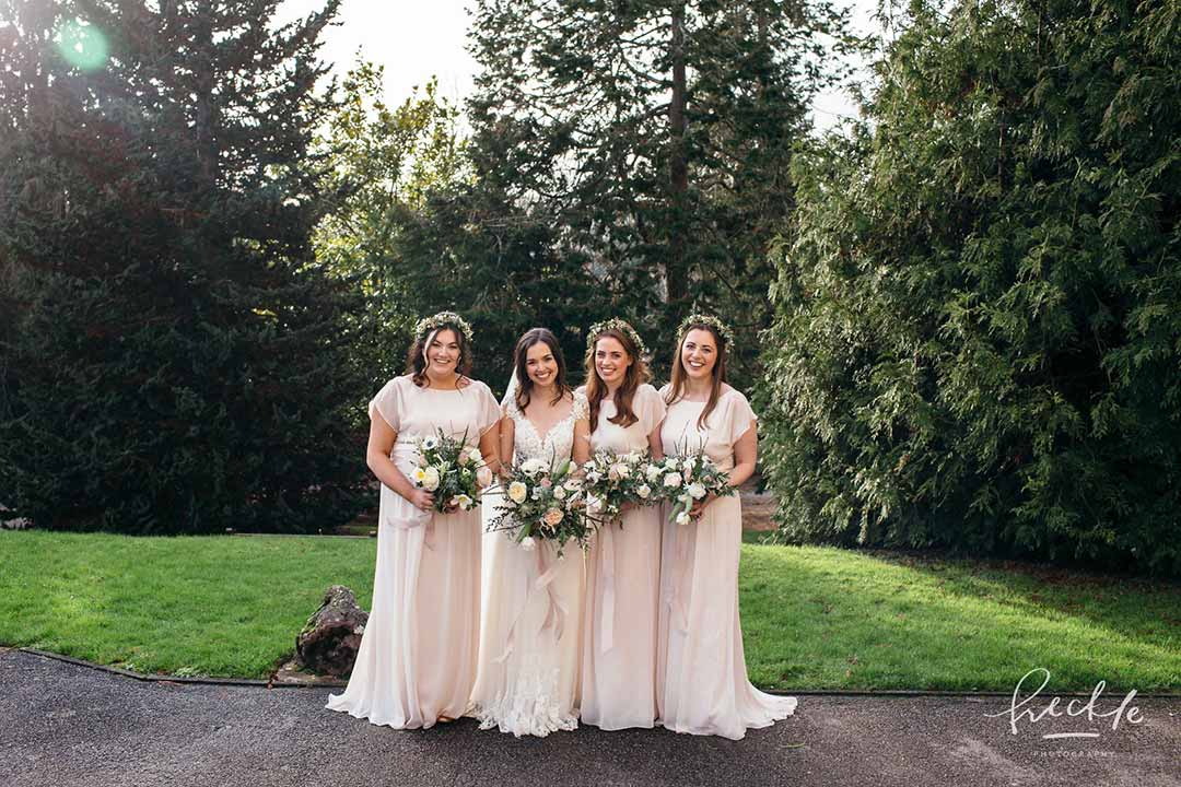 Bride and bridesmaids at winter wedding holding flowers