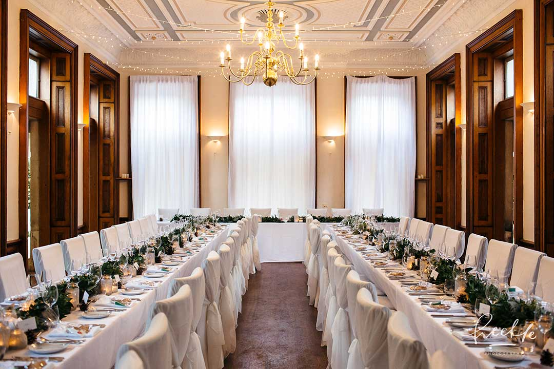 Long tables decorated with winter wedding flowers