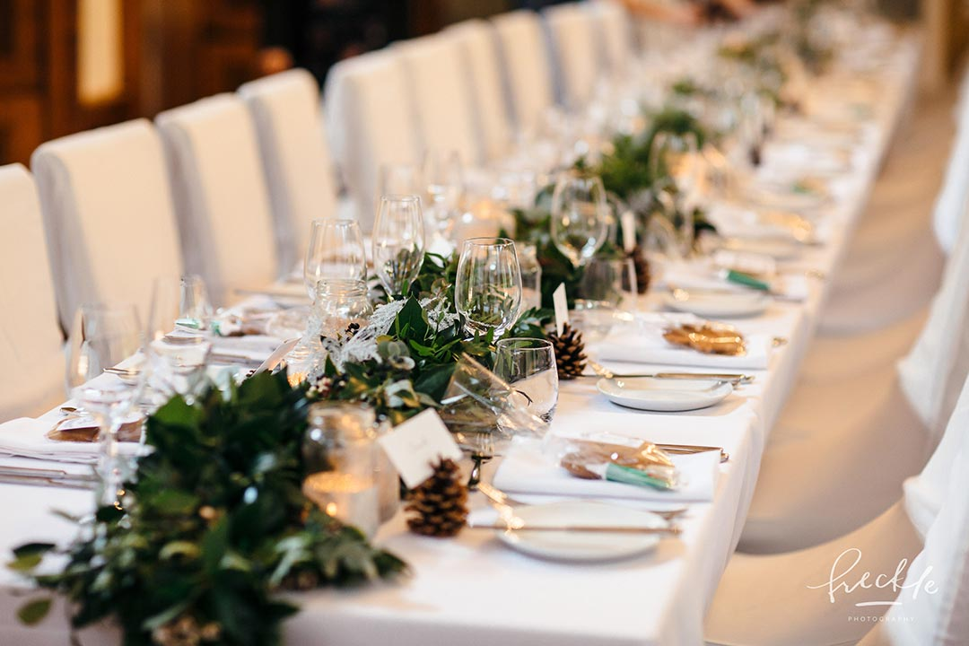 Long tables decorated with Christmas wedding flowers