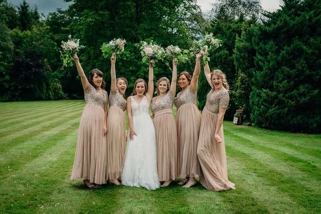 bride and bridesmaids holding up bouquets