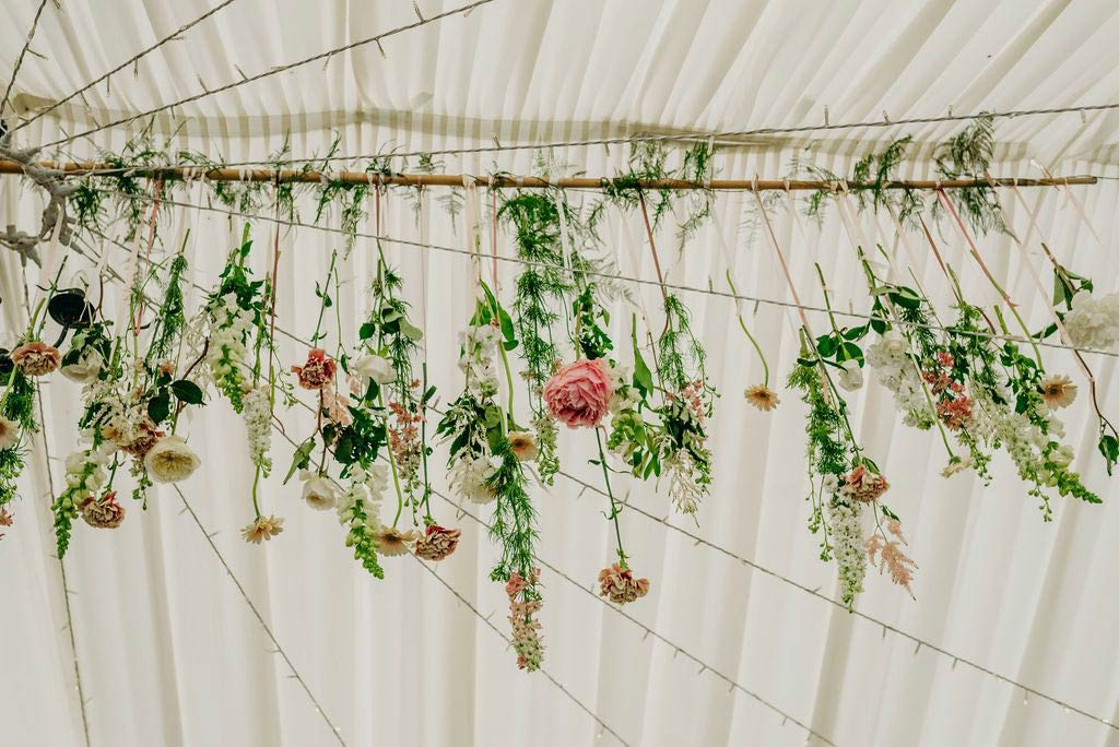 Wedding flowers decorating the marquee roof