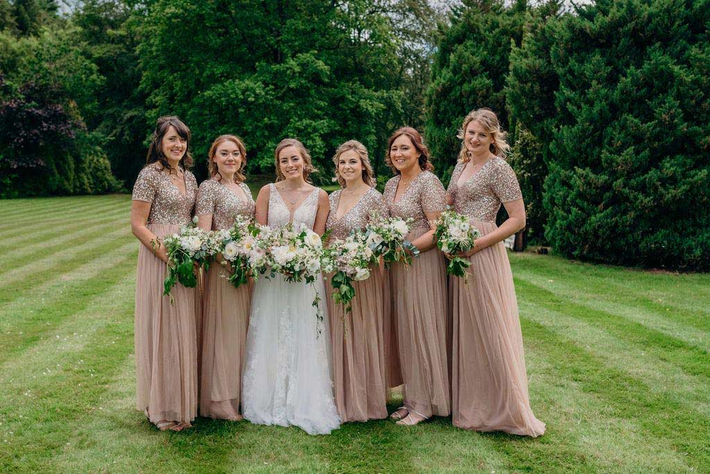 Bride with bridesmaids on lawn
