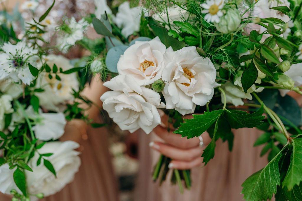 close up or bride's wedding bouquet