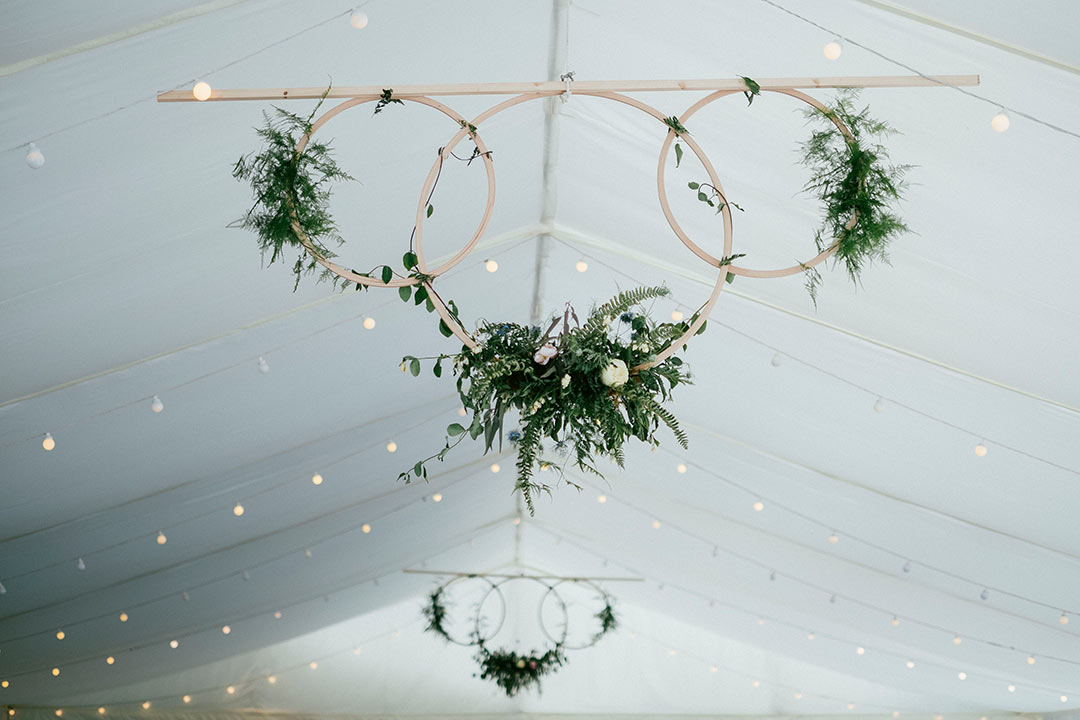 Flower hoops hanging from marquee