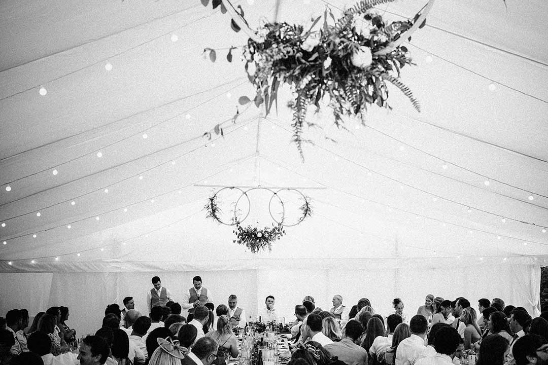 Marquee top decorated with wedding flowers