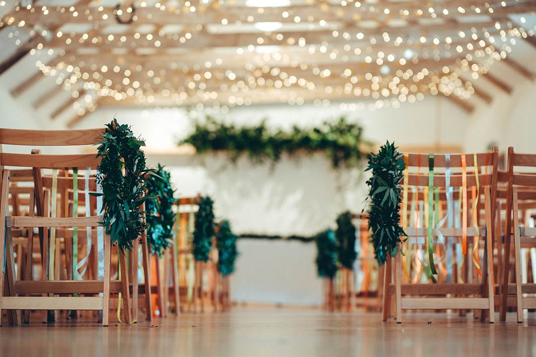 wedding venue decorated with greenery