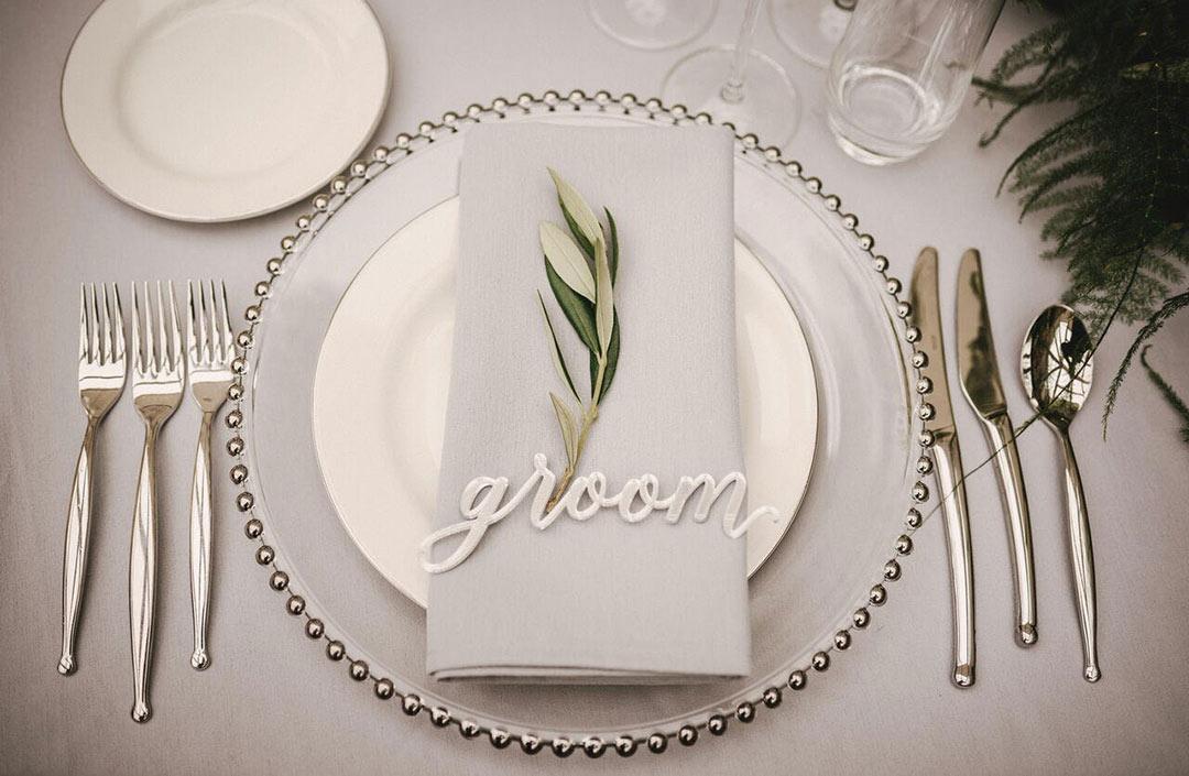 Green sprig on Groom's napkin