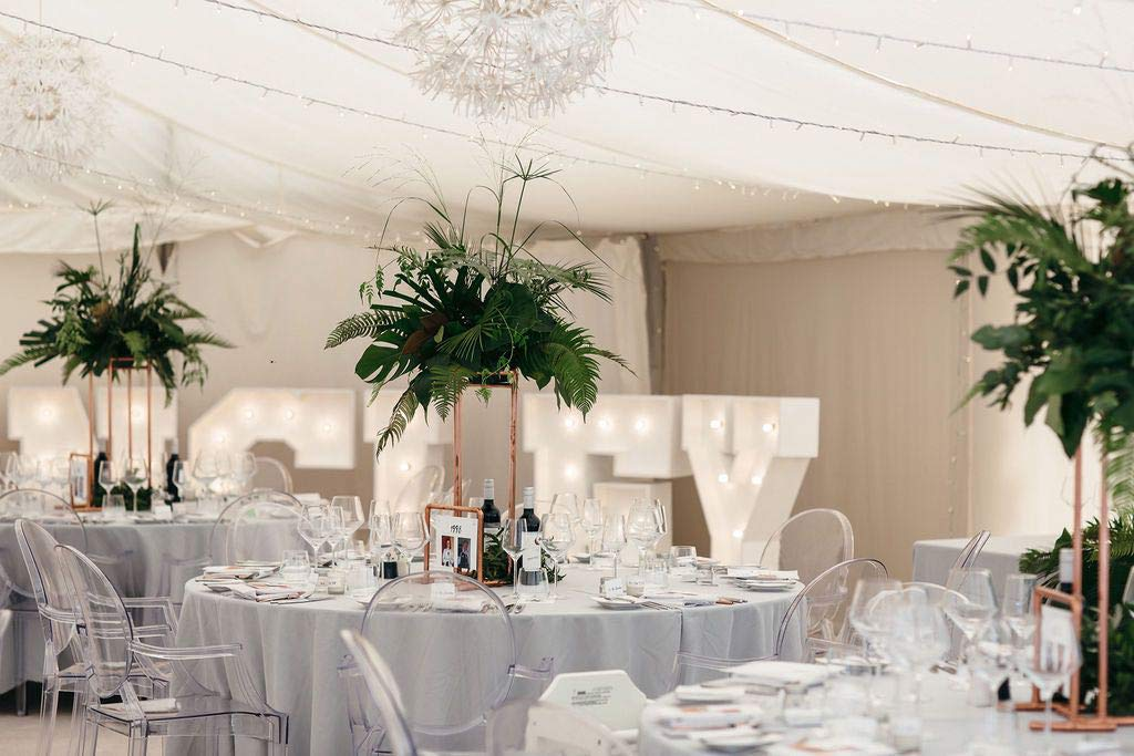 Green foliage decorating wedding marquee