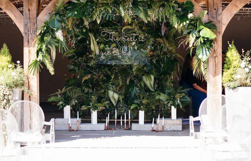 Green and white flower wedding arch