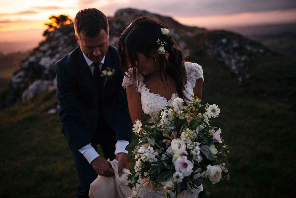 Bride and groom with Dartmoor sunset behind