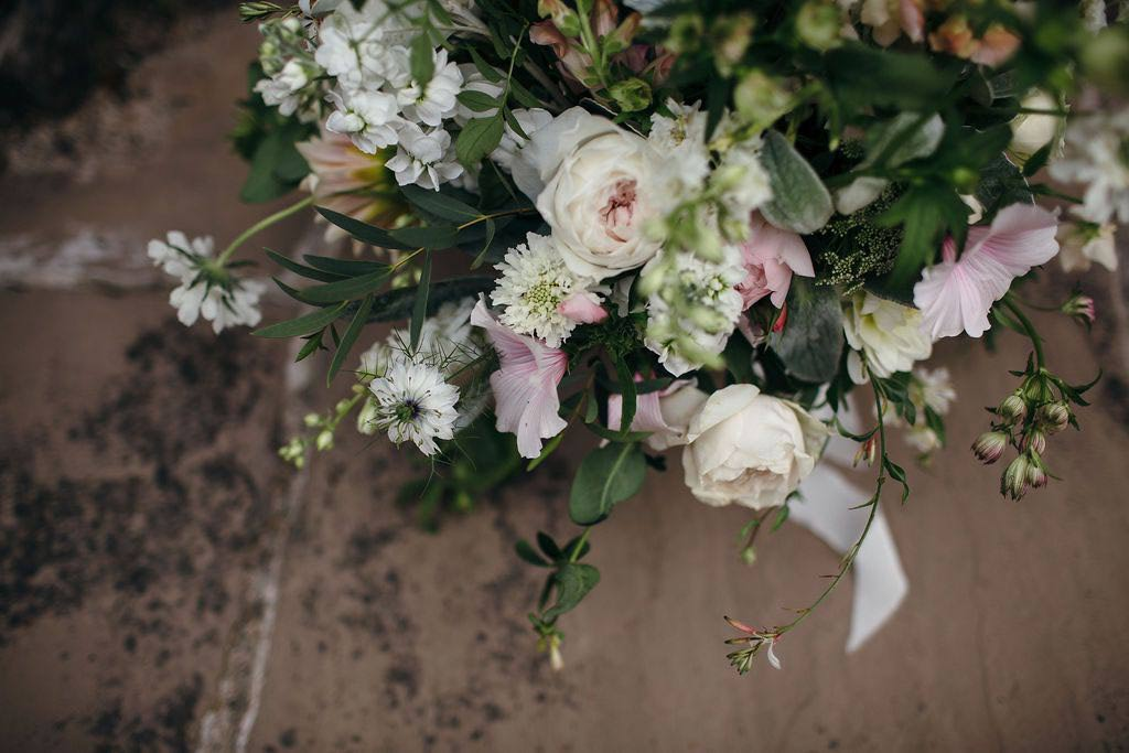 Bride's wedding bouquet on granite surface