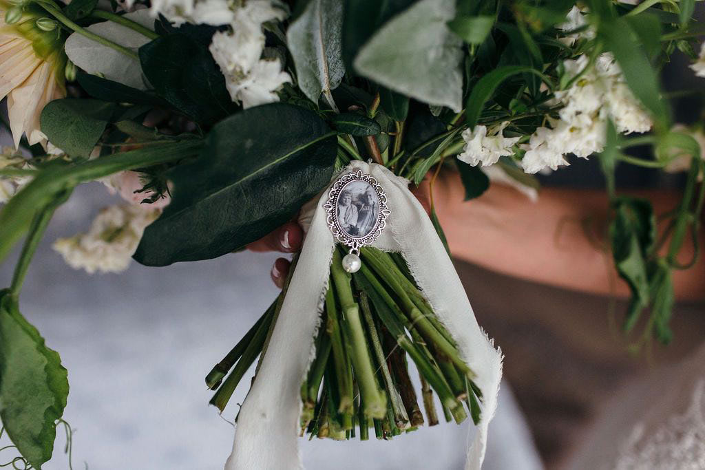 Wedding bouquet with old photo attached