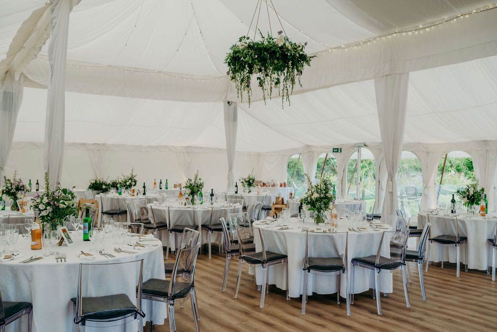 Wedding marquee decorated with flowers for reception