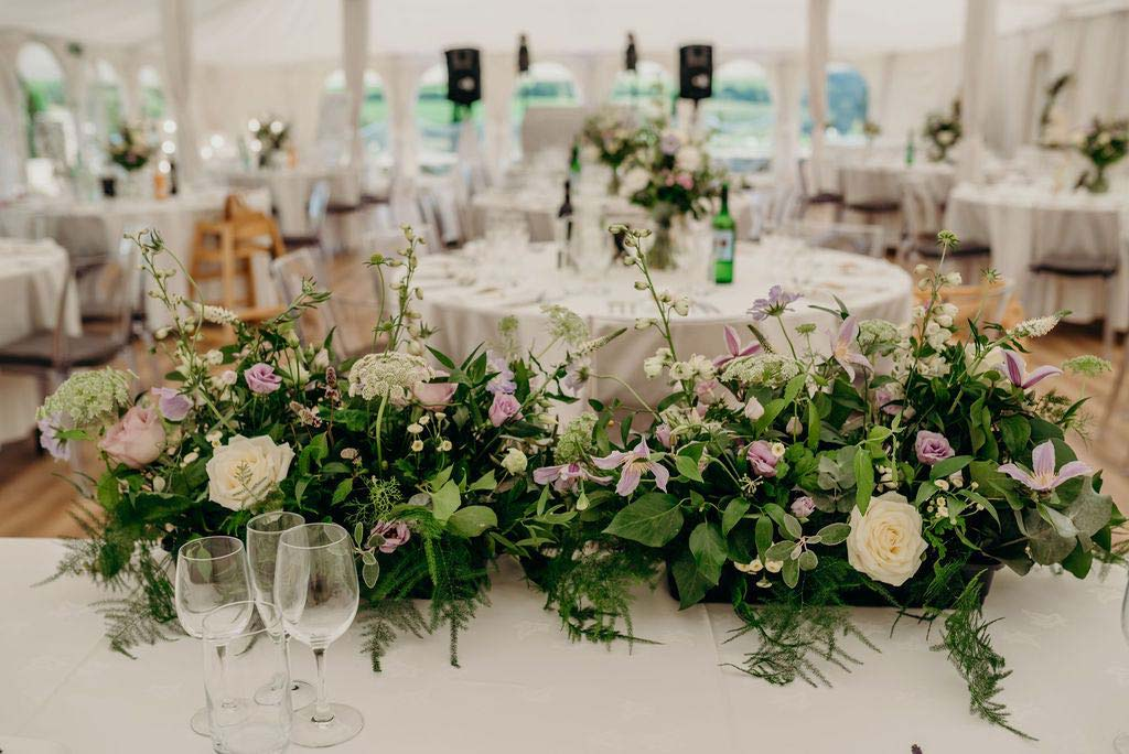 Wedding top table decorated with pink and white flowers