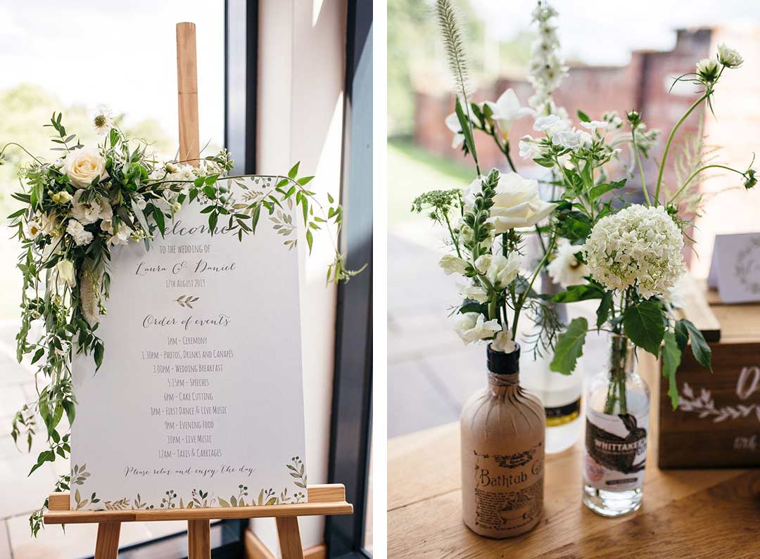 Menu decorated with wedding flowers and flowers in old gin bottles