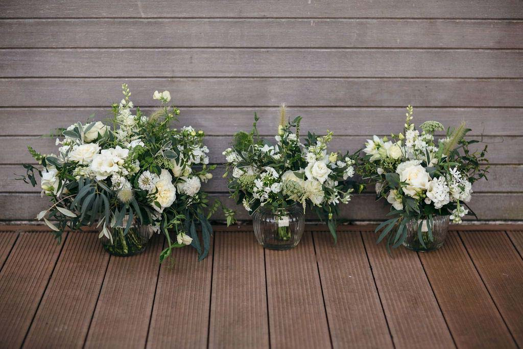 Wedding flowers in vases ready for reception