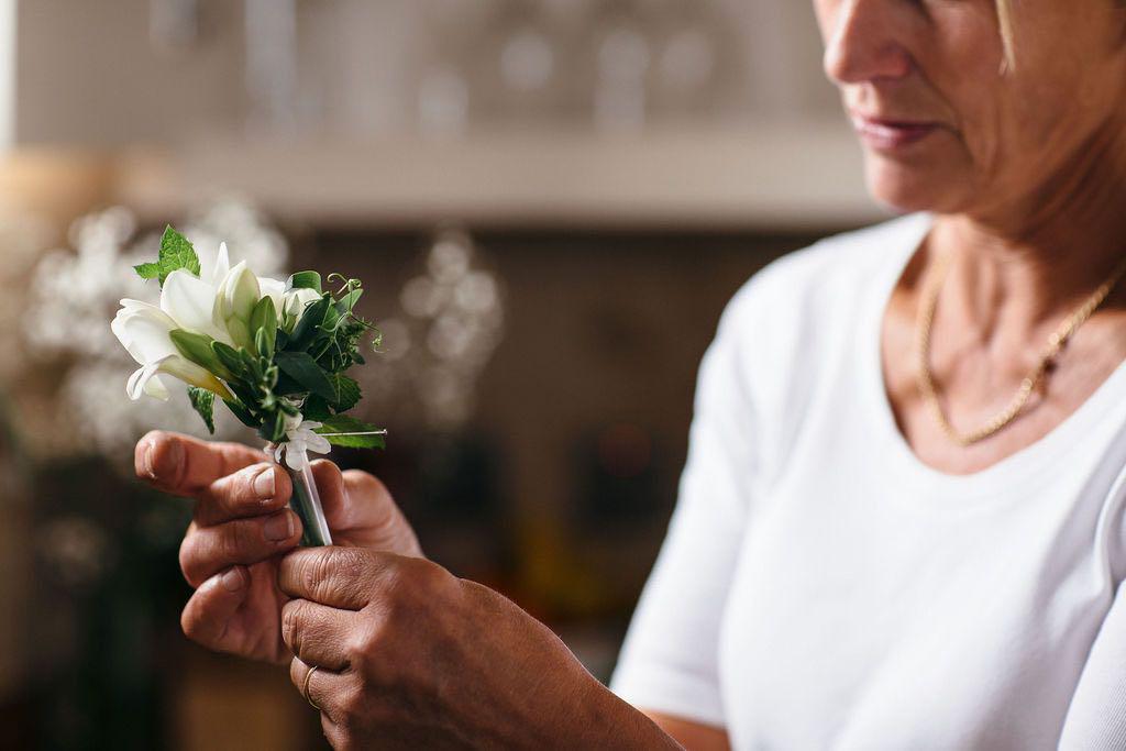 Debbie Morris adding finishing touches to wedding buttonhole