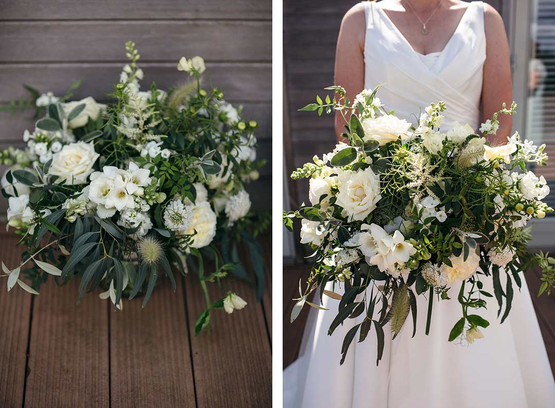 Bride holding green and white wedding  bouquet