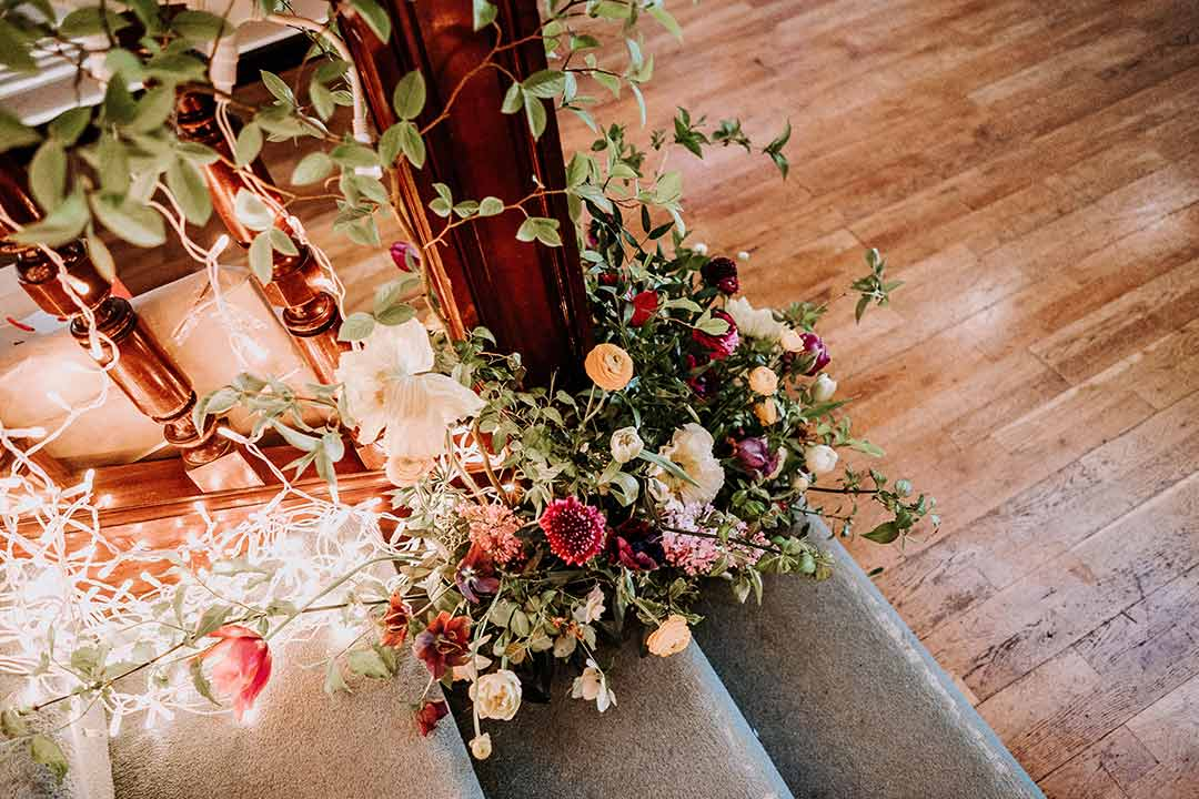 Wedding flowers around staircase