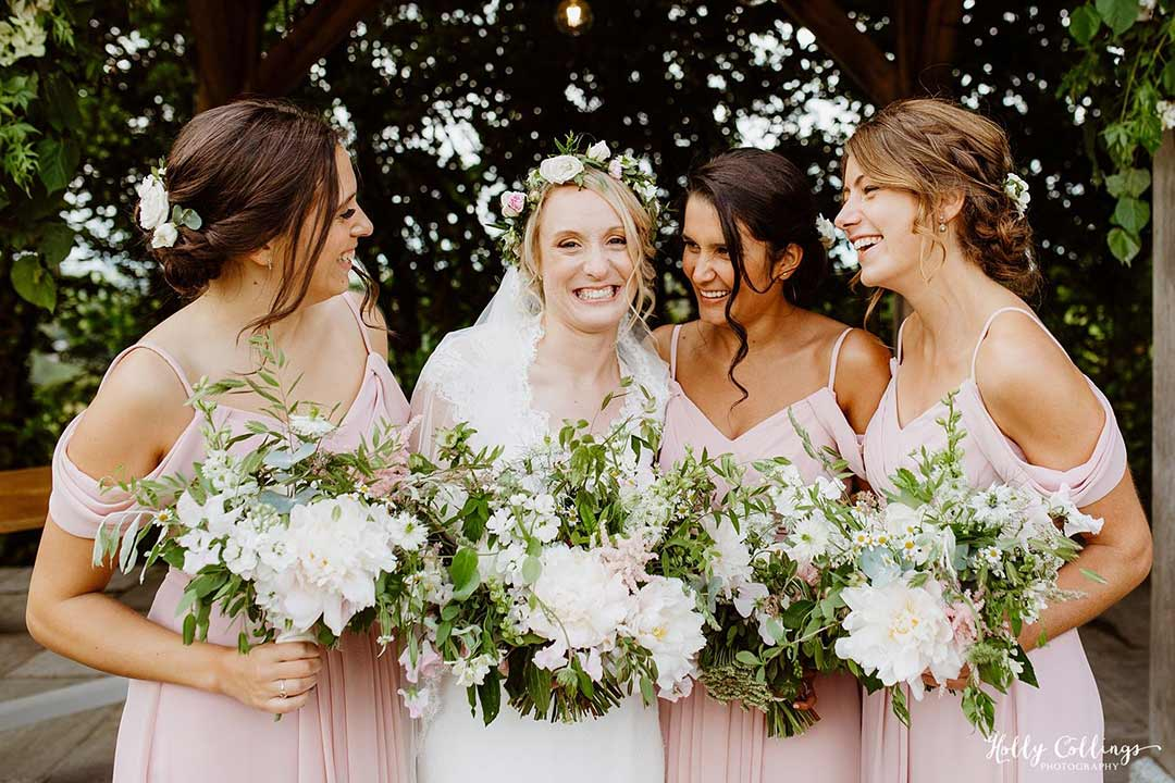 Bride with her bridesmaids in pink dresses