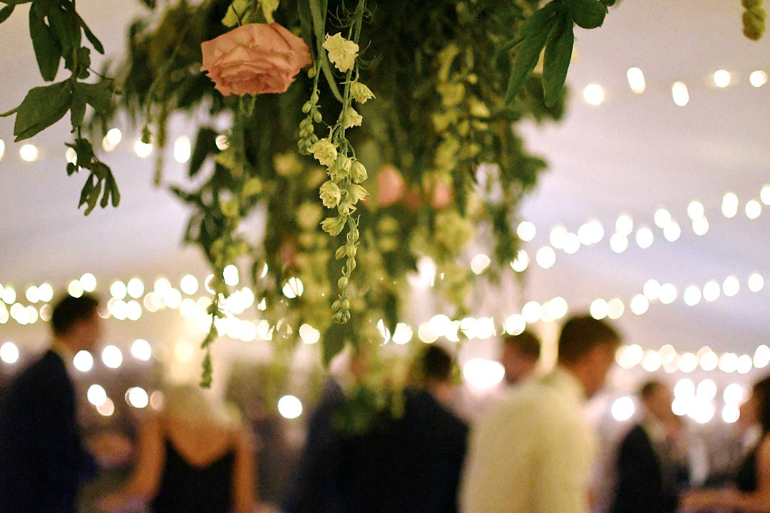 Suspended orange and white wedding flowers