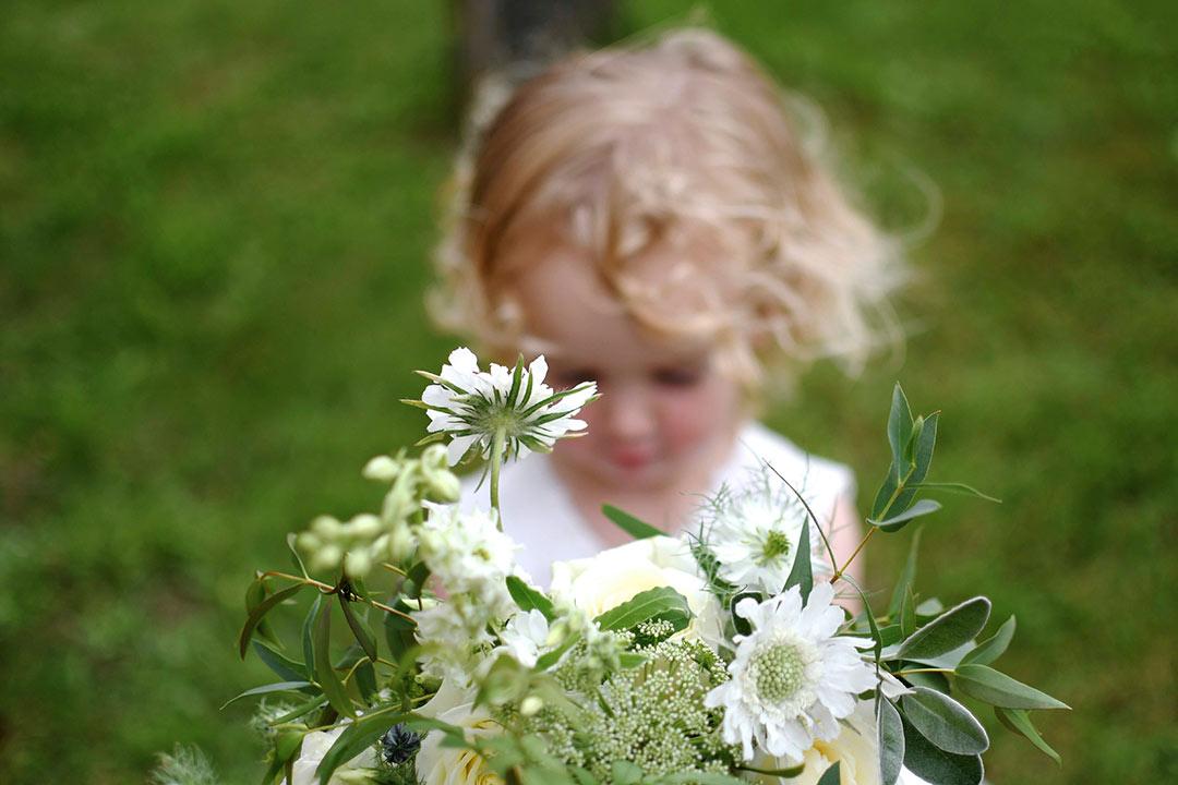 Little bridesmaid holding bouquet