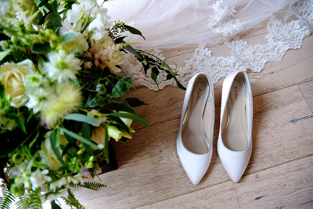 wedding bouquet with veil and wedding shoes