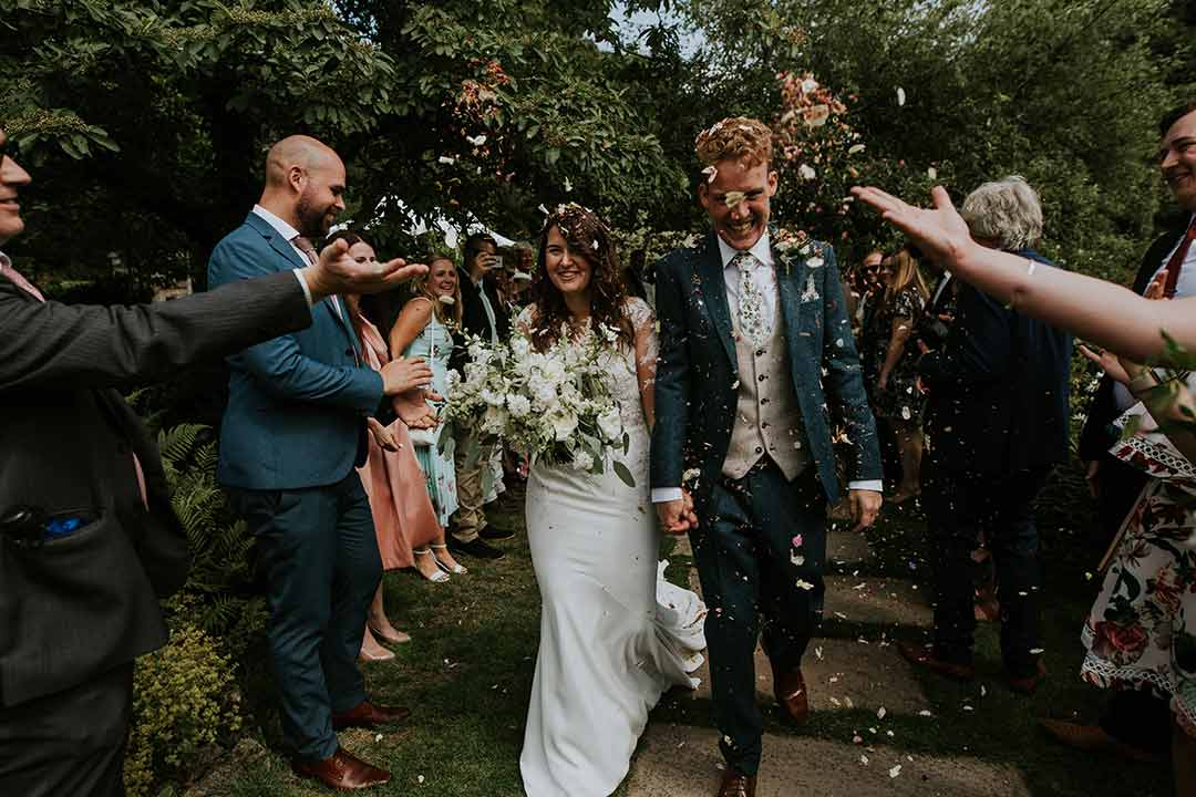 confetti thrown over newly married couple