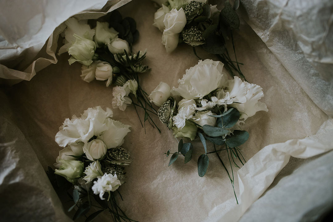 White buttonholes for wedding
