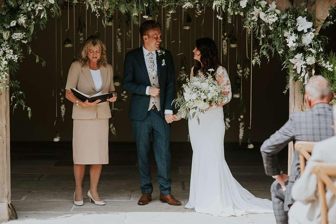 Wedding under suspended white wedding flowers