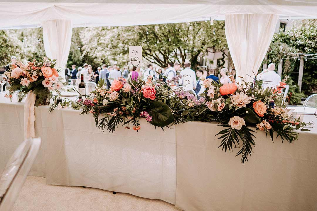 Pink and green wedding flowers decoration top table