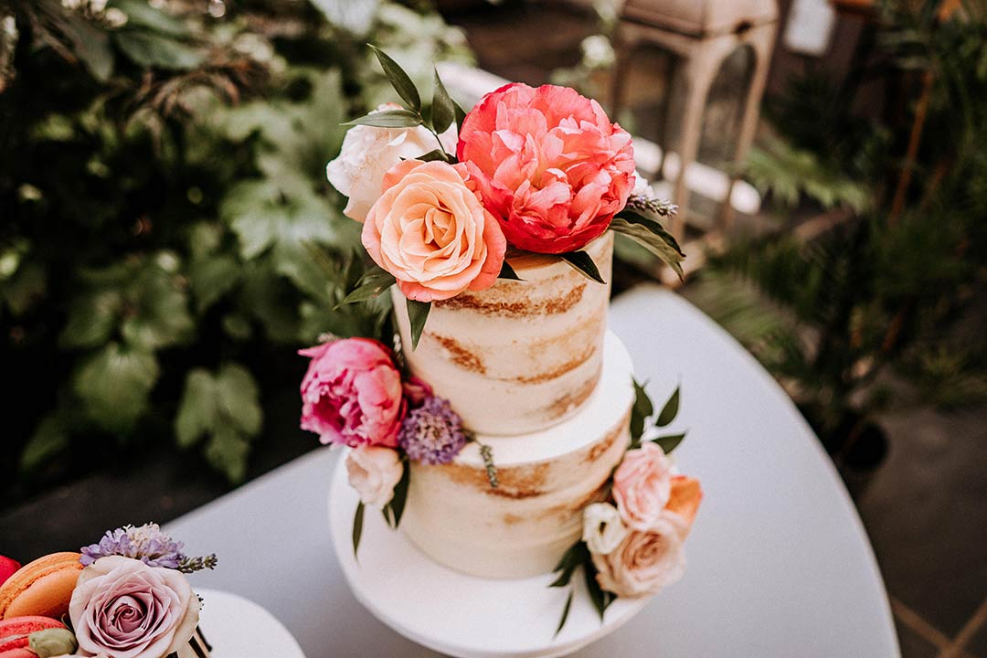 Wedding cake adorned with wedding flowers