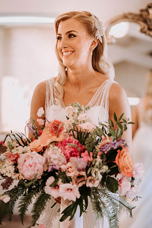 Bride with pink wedding bouquet